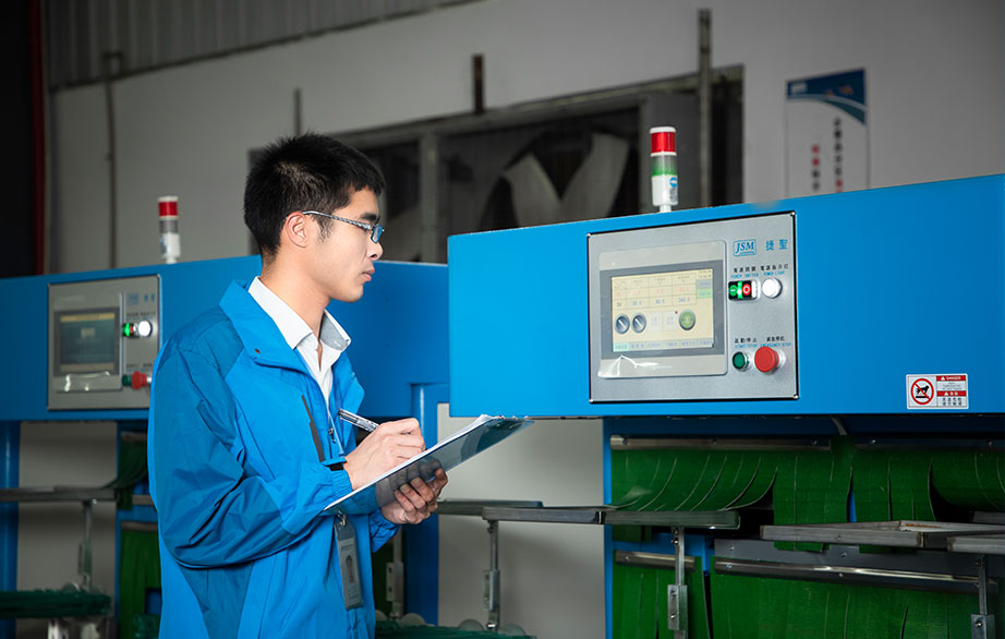 a technician in blue is checking machine condition and conducting after sales inspection